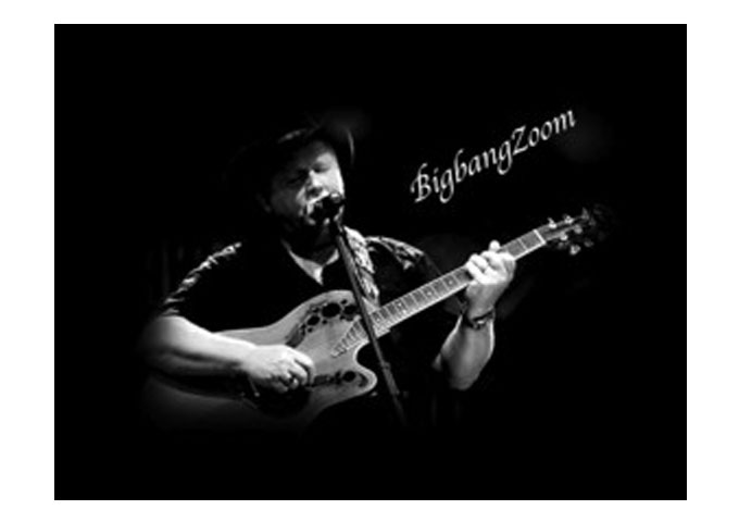 Globetrotting Singer-songwriter Bigbangzoom:  Just an Old Cat With An Acoustic Guitar!